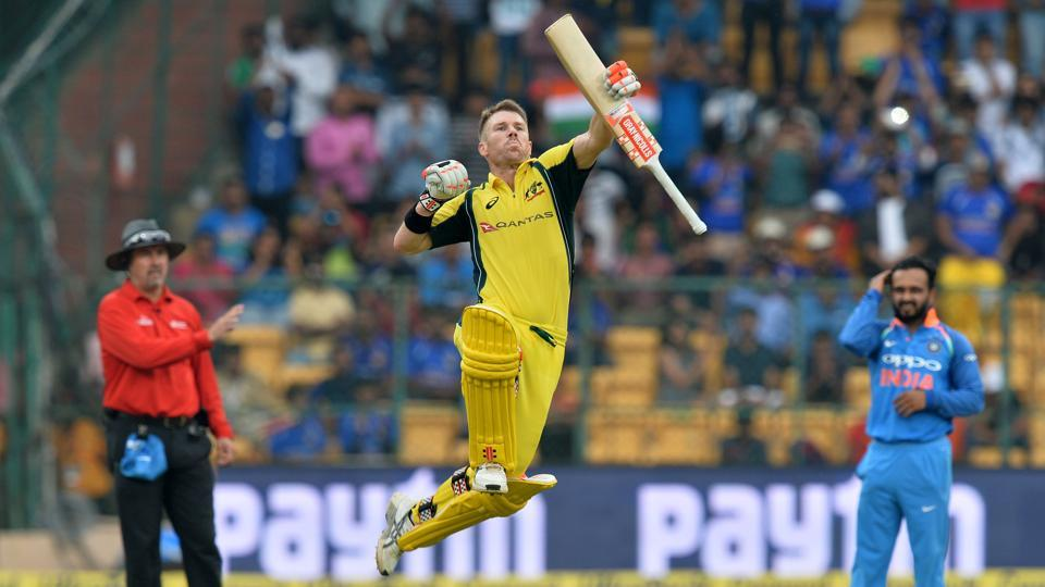 Australian cricketer David Warner jumps to celebrate his century during the fourth ODI against Indiaat the M. Chinnaswamy Stadium in Bangalore on Thursday.