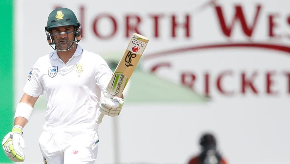 South African batsman Dean Elgar raises his bat as he celebrates scoring his century during the first day of the first Test against Bangladesh on Thursday in Potchefstroom.