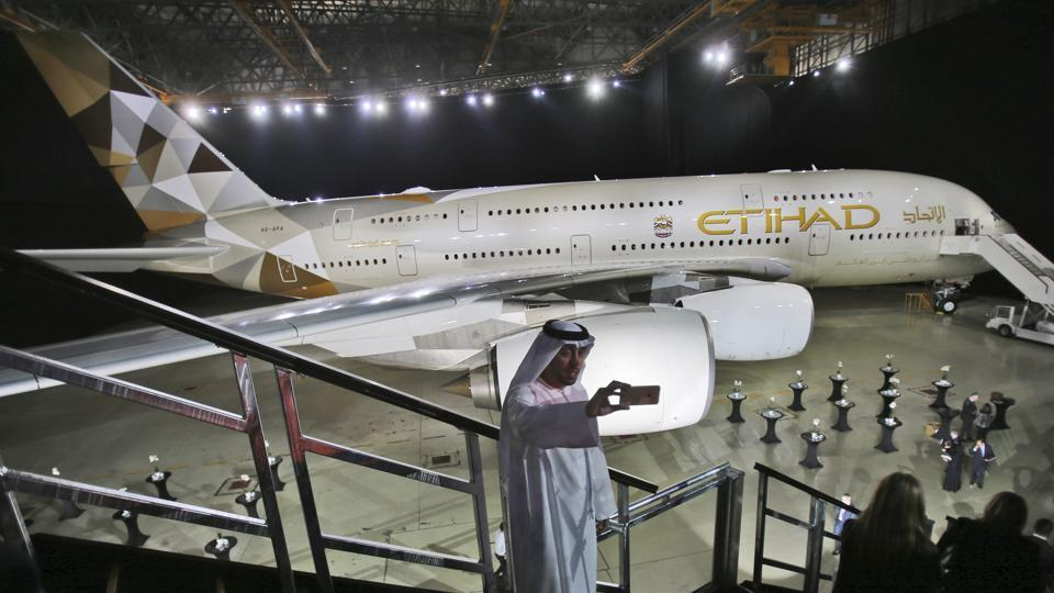 A man takes a selfie in front of a new Etihad Airways A380 in Abu Dhabi, United Arab Emirates.