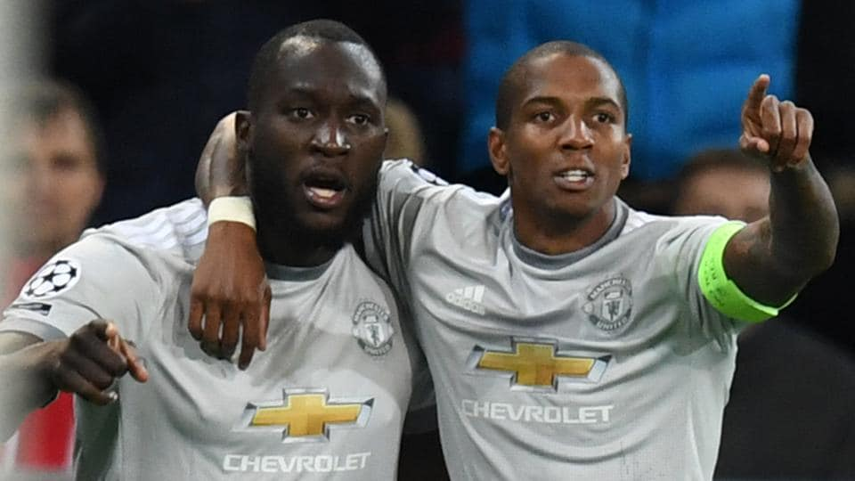 Manchester United's Romelu Lukaku (L) celebrates with teammate Ashley Young after scoring a goal during the UEFA Champions League Group A football match between PFC CSKA Moscow and Manchester United FC in Moscow on September 27, 2017.