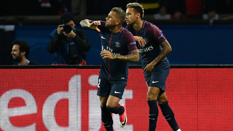 Neymar and his Paris Saint-Germain teammate Dani Alves celebrate after scoring against Bayern Munich in an UEFA Champions League match.