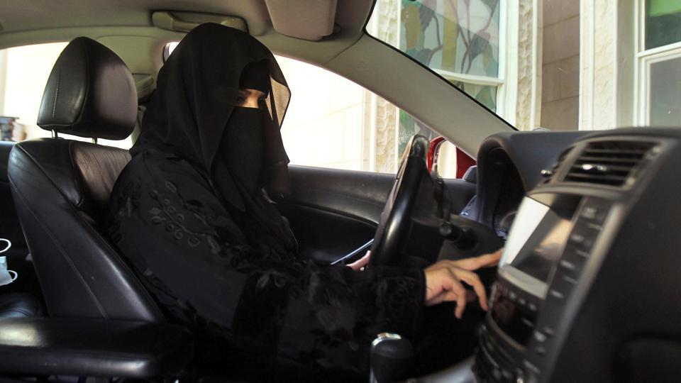 A woman drives a car in Saudi Arabia.