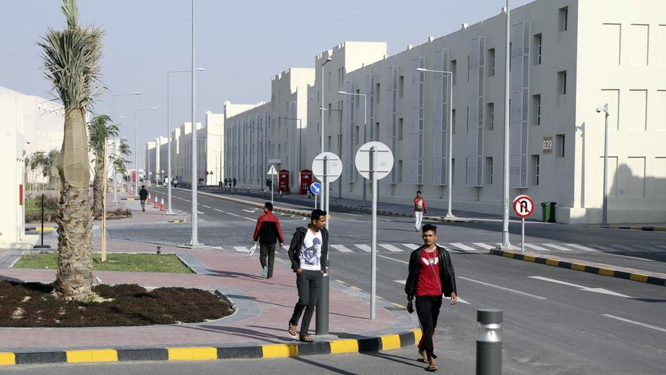 FILE PHOTO: Migrant workers walk at Labor City, Qatar, January 13, 2016. REUTERS/Stringer/File Photo