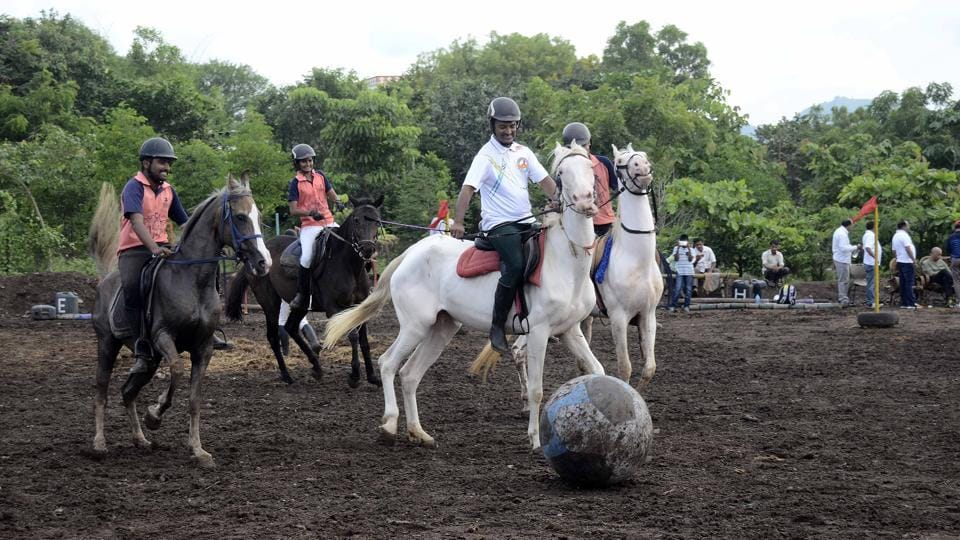 A football match involving horses was organised by the Digvijay Horse riding academy on the Shivshrushti ground in Ambegaon, Pune, under the initiative of the 'Maharashtra Football Mission One Million' by Maharashtra sports department and district sports council to promote football and the upcoming under-17 football World Cup, which will be held in India. (RAVINDRAJOSHI/HT PHOTO)