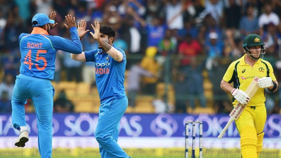 Umesh Yadav of Indian cricket team celebrates with teammates after taking the wicket of Australia cricket team's Aaron Finch in the 4th ODI at Chinnaswamy Stadium in Bangalore on Thursday.