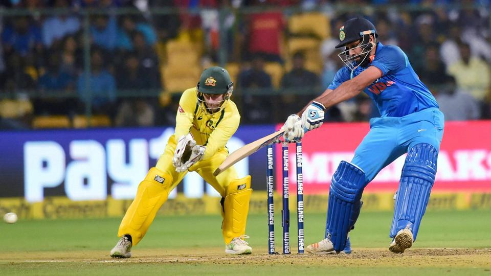 India's Rohit Sharma plays a shot en route to his half century against Australia. (PTI)