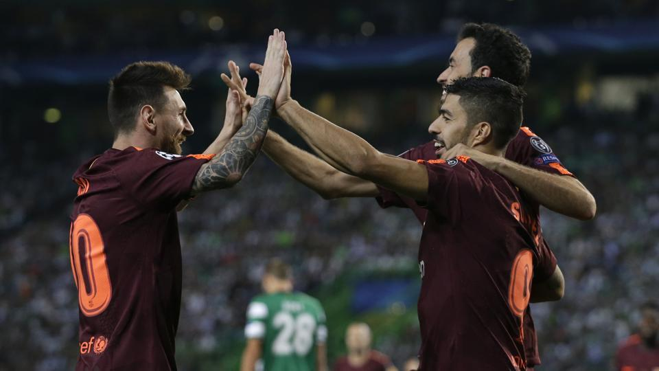 Barcelona's Lionel Messi celebrates with teammates after their team scored against Sporting Lisbon at UEFA Champiosn League.