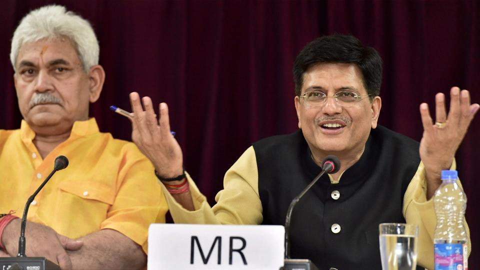 Railway minister Piyush Goyal with MoS Manoj Sinha at a press conference in New Delhi on Thursday.