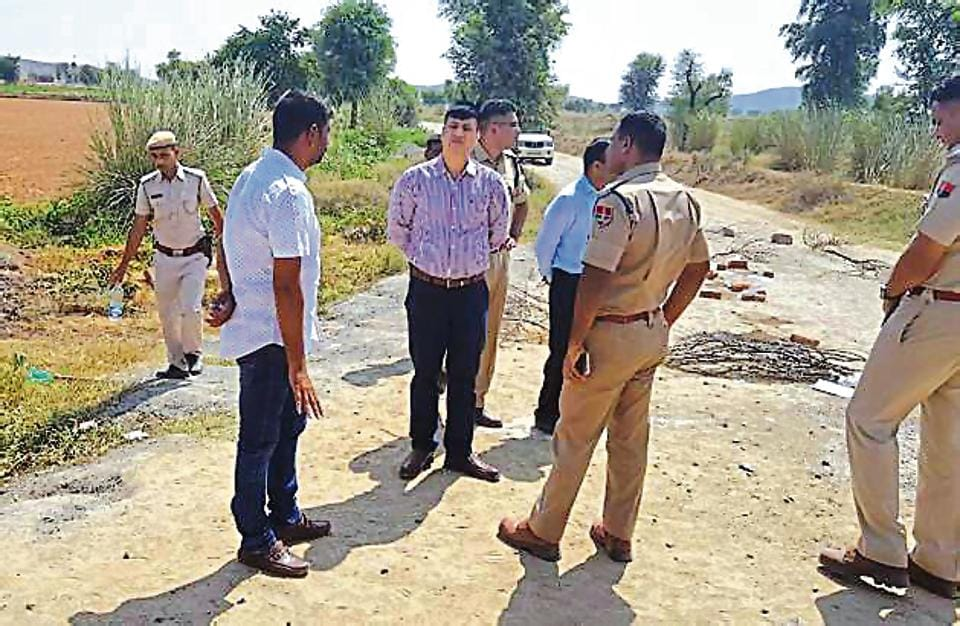 Alwar superintendent of police Rahul Prakash and other police officials inspect the spot from where the charred bodies were found.