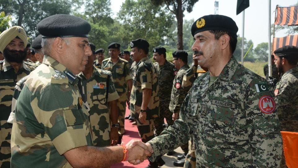 DIG BSF Jammu Sector P S Dhiman with  Brig Amjad Hussain of Pakistan Rangers at the  sector commander level flag meeting in RS Pura sector in Jammu on Friday.