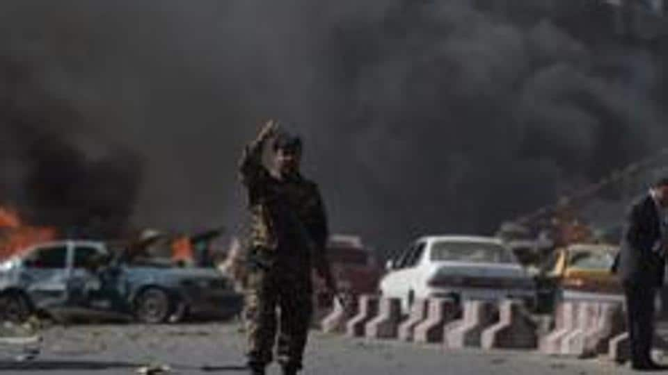 An Afghan security force member stands at the site of a car bomb attack in Kabul in May 31 2017. An explosion rocked the Afghan capital on Friday, killing at least one person.