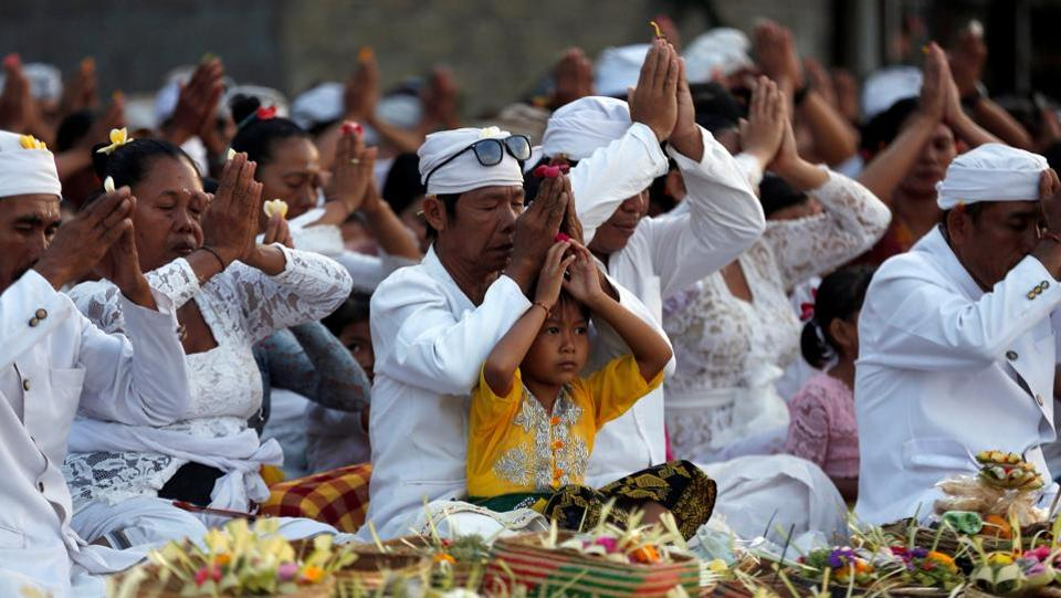 Balinese citizens pray for safety near Mount Agung, in Amed, Bali. It's possible the volcano could calm down, but it is unlikely without pressure being released in some way. Heather Handley, assistant Earth sciences professor at Sydney's Macquarie University said there were signs of  gas releases and earthquakes in 1989 and swelling of the volcano between 2007 and 2009 without any subsequent eruptions. But this time around, the buildup of activity is much more significant. (Darren Whiteside / REUTERS)