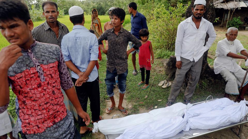 Bodies of four Rohingya refugee children who died after their boat capsized as they were fleeing from Myanmar are taken to their funeral near Cox's Bazar, Bangladesh, onSeptember 29, 2017.