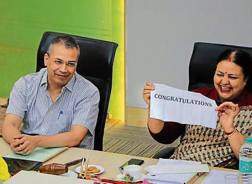 Mayor Asha Jaswal congratulating MC commissioner B Purushartha for his transfer, during the monthly House meeting at MC building in Sector 17, Chandigarh, on Friday.