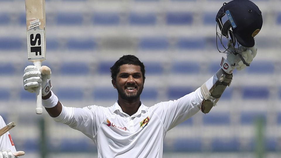 Sri Lanka's batsman Dinesh Chandimal celebrates reaching his century during the second day of the first test cricket match against Pakistan in Abu Dhabi on Friday.