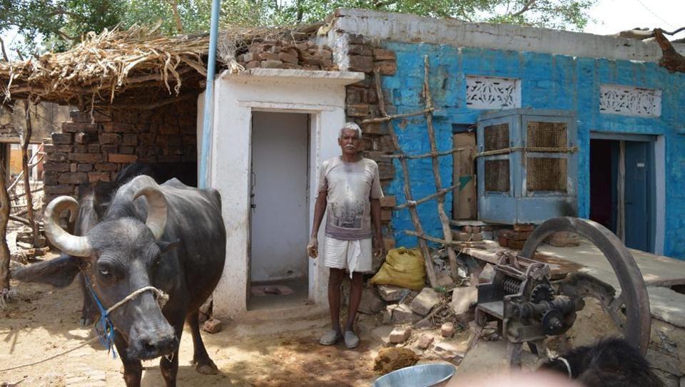Farmer Gangu Ram in village Hastinapur being tagged as ODF (open defecation free) under Morar block in district Gwalior.