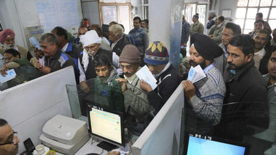 People wait in queue to deposit demonetised banknotes in December 2016. The demonetisation of 1000 and 500 rupee notes was a major overhaul that severely affected cashflow in the country.