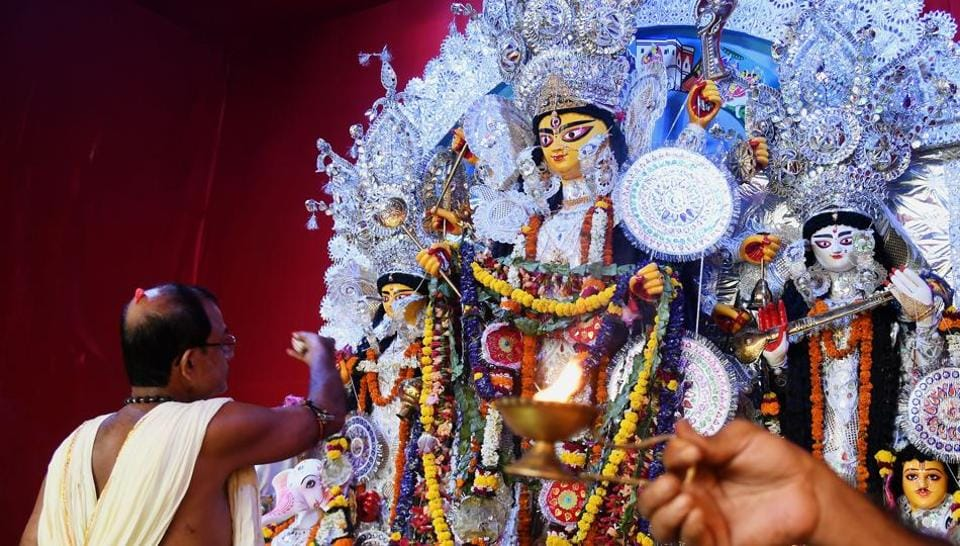 Priests perform rituals to worship the goddess Durga at a pandal for the celebrations during the Durga Puja festival in Kolkata on September 28, 2017.