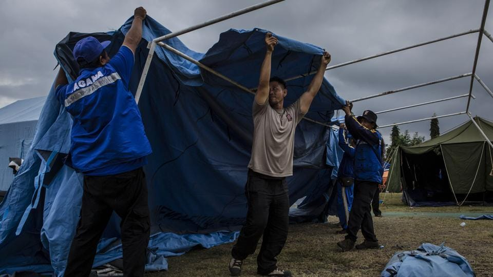 Volunteers erect a temporary tent at an evacuation center in Klungkung regency, Bali. Mount Agung has been at its highest alert level for a week. Those who have fled are scattered in more than 500 locations across Bali, taking shelter in temporary camps, sports centers and other public buildings. 'The volcano is bulging, causing a large number of small cracks to form and the earth to vibrate,' said David Boutelier, a geologist at Australia's University of Newcastle. (Ulet Ifansasti / Getty Images)