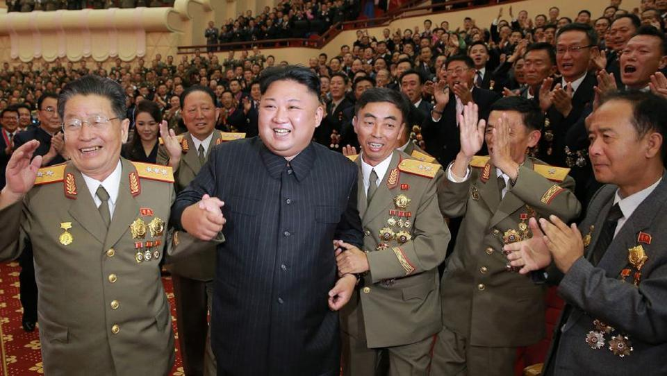 This undated picture released by North Korea's official Korean Central News Agency (KCNA) on September 10, 2017 shows North Korean leader Kim Jong-Un (front 2nd L) attending an art performance dedicated to nuclear scientists and technicians, who worked on a hydrogen bomb which the regime claimed to have successfully tested, at the People's Theatre in Pyongyang. /
