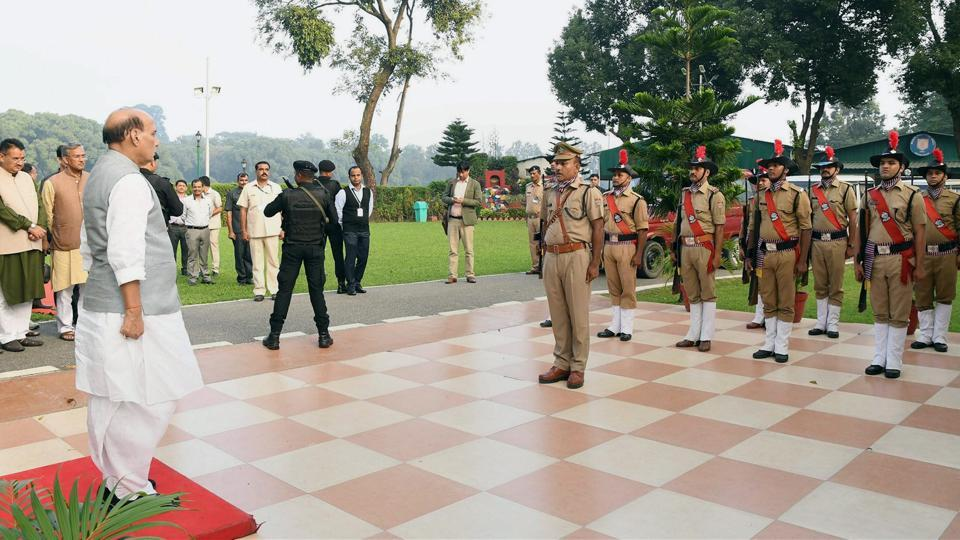 Union home minister Rajnath Singh takes the salute of the Guard of Honour, on his arrival in Dehradun on Friday.