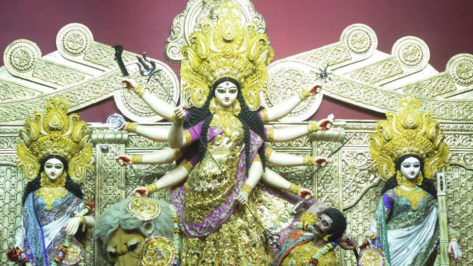 All the idols at Santosh Mitra Square Durga Puja are wearing ensembles designed by fashion designer Agni Mitra Paul.