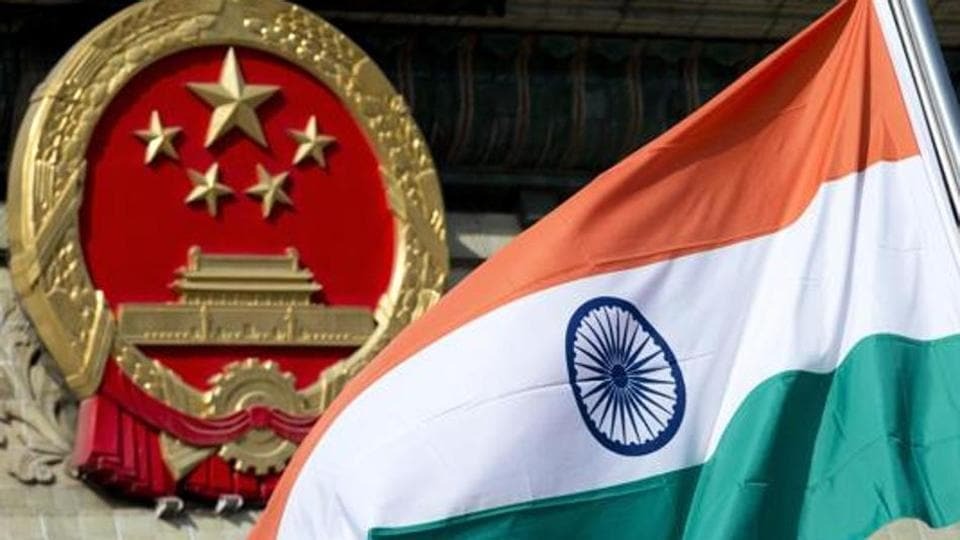 A file photo of an Indian flag next to the Chinese national emblem during a welcome ceremony for visiting Indian officials outside the Great Hall of the People in Beijing.