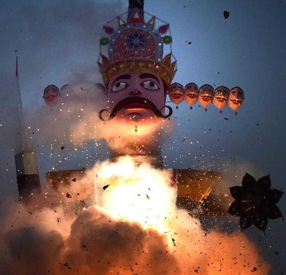 The effigy of demon god Ravana being burnt on the occasion of Dussehra in Chandigarh on Saturday.  (Sanjeev Sharma/HT)
