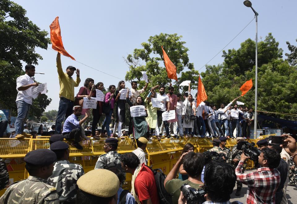 Akhil Bharatiya Vidyarthi Parishad (ABVP) activists protest in New Delhi against lathi charge in Banaras Hindu University campus