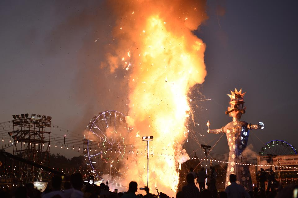 Effigy of Ravana goes up in flames during Dussehra celebrations at Luv Kush Ramlila of Lal Qila. The final act of burning Ravana's effigy is to signify victory over evil. (Burhaan Kinu / HT PHOTO)