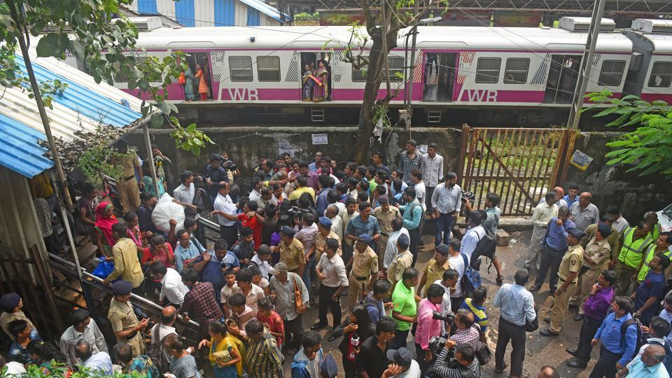 Police officers try to control crowd after stampede at Elphinstone road in Mumbai on September 29.
