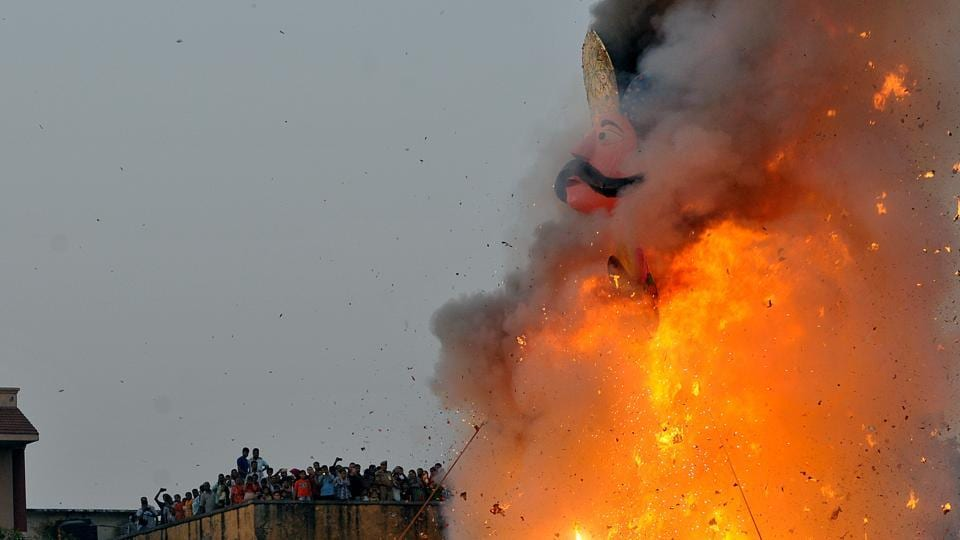 An effigy of Ravana goes up in flames marking the end of Dussehra in Jammu on Saturday.  (Nitin Kanotra/HT)