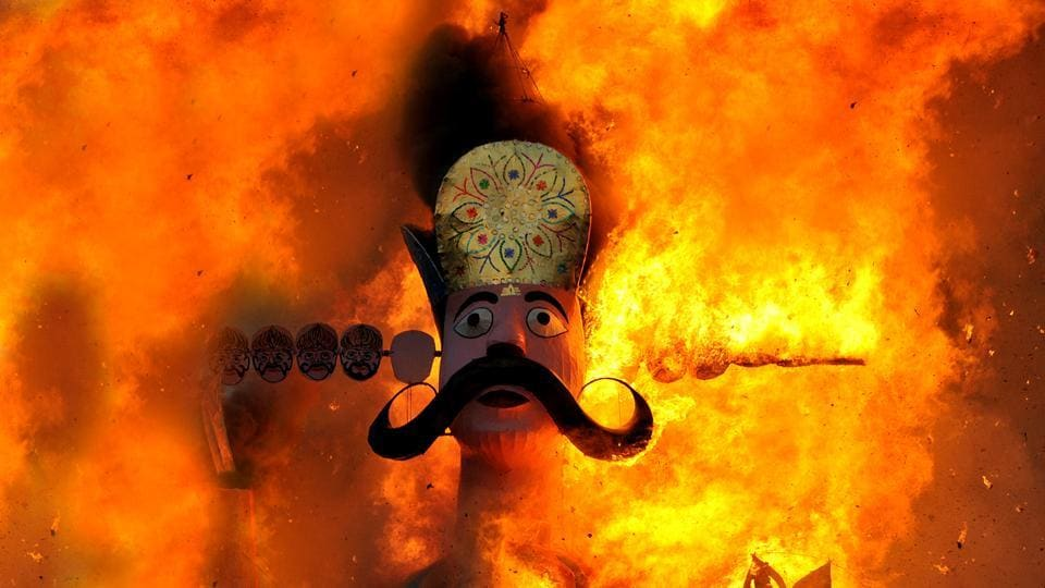 An effigy of demon king Ravana goes up in flames marking the end of Dussehra festival in Jammu. Dussehra or Vijaya Dashami, marks the culmination of the 10-day long Navratri festival, in which Goddess Durga is worshipped as well as the festive proceedings of Durga Puja also came to an end with the immersion of idols. (Nitin Kanotra / HT Photo)