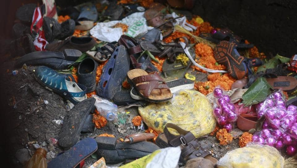 Footwear and other items lie at the site of a pedestrian bridge, connecting Elphinstone and Parel stations where a stampede broke out, in Mumbai on September 29.