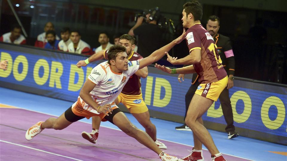 Players of Puneri Paltan (white jersey) and UP Yoddha in action during a Pro Kabaddi League match at Jawaharlal Nehru Indoor Stadium in Chennai on Saturday.