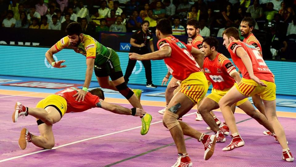Players of Patna Pirates (Green) and Gujrat Fortune Giants (Yellow-Red) in action during Pro Kabaddi League match at Jawaharlal Nehru Indoor Stadium in Chennai on Friday.