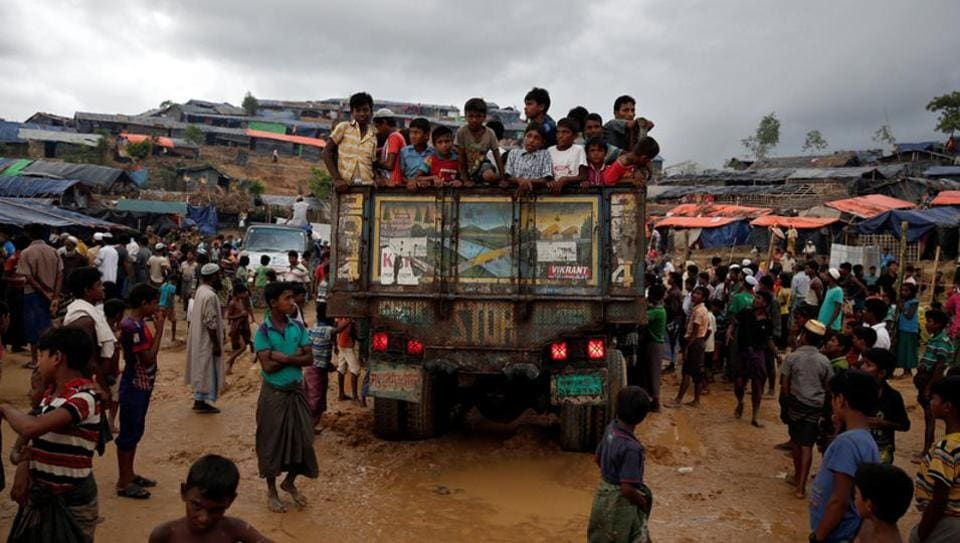 Rohingya refugee children gather on a truck in Cox's Bazar, Bangladesh on September 28.