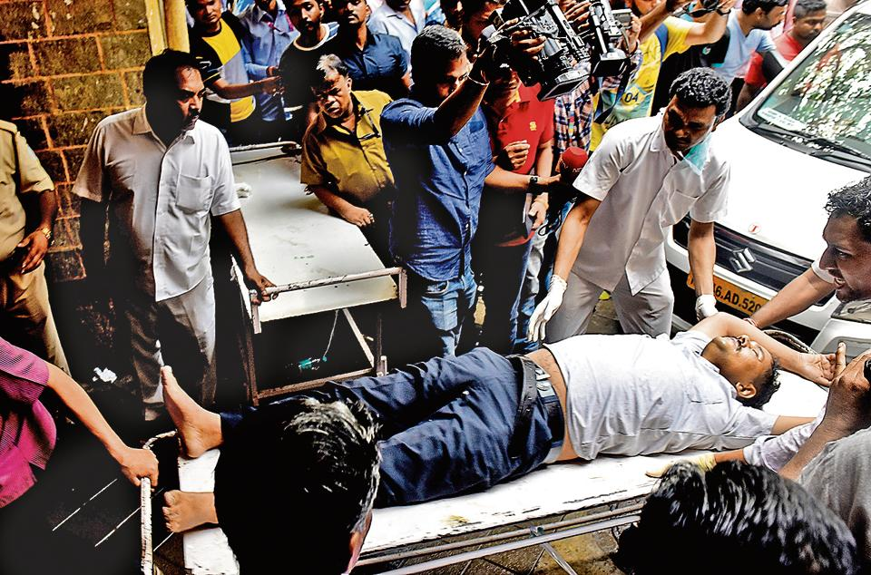 One of the 37 injured in the stampede at Elphinstone Railway station is brought to KEM Hospital on Friday.