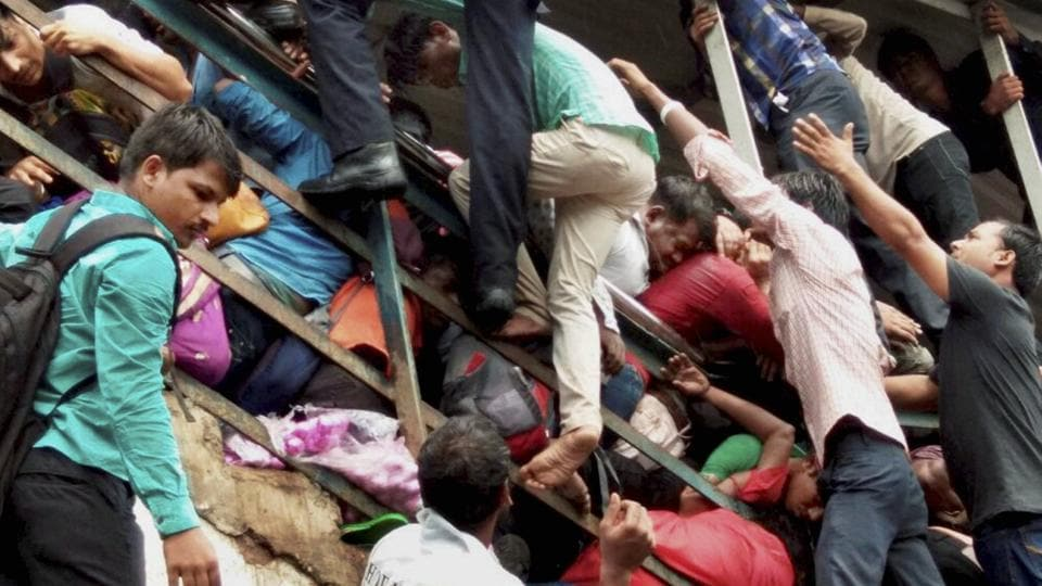 Passengers caught in a stampede at Elphinstone railway station's foot over bridge in Mumbai on Friday.