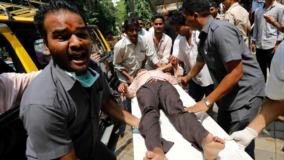A stampede victim is carried on a stretcher at a hospital in Mumbai, India September 29.