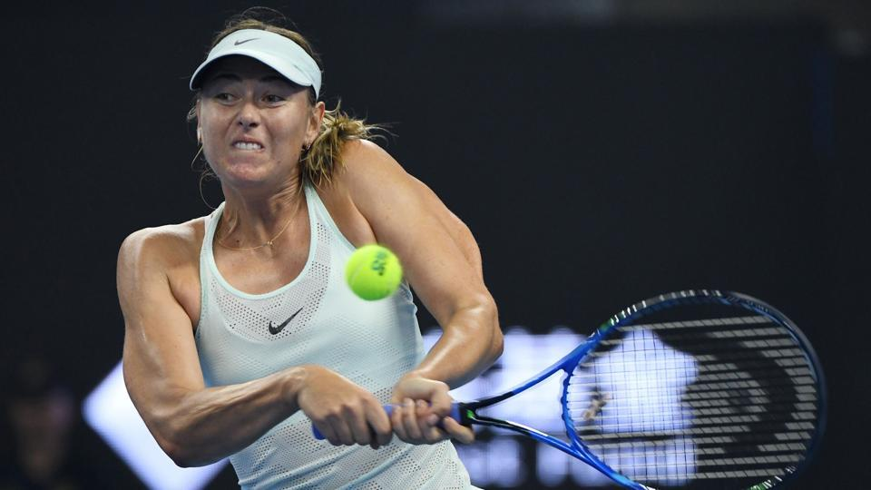 Maria Sharapova of Russia hits a return to Anastasija Sevastova of Latvia during their first round match at the China Open tennis tournament in Beijing on Sunday.