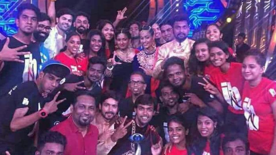 Bigg Boss Tamil winner Aarav with other contestants and friends after claiming the trophy.