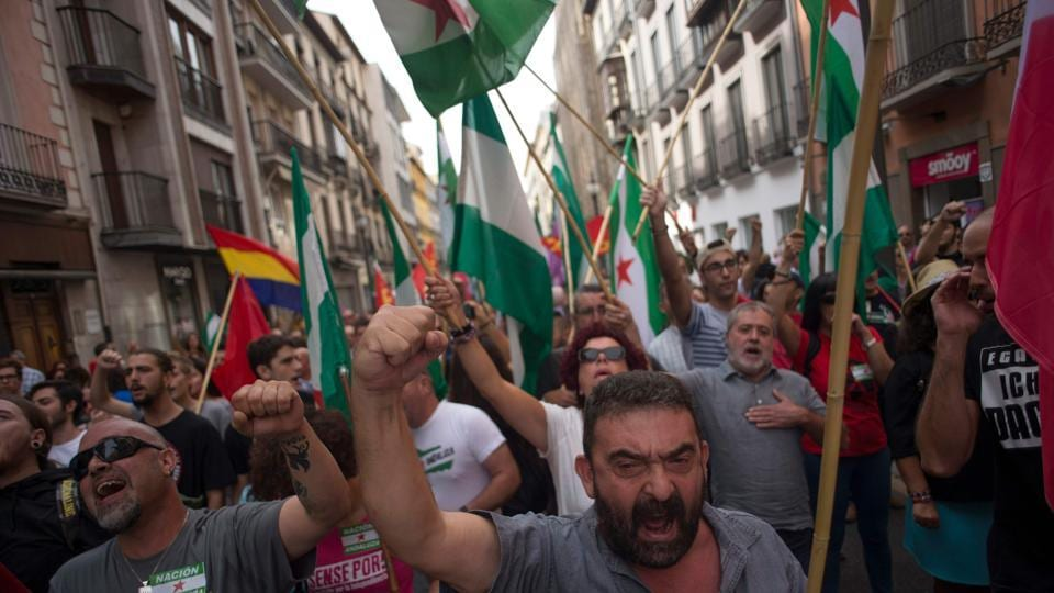 People hold Andalusian during a demonstration in support of the referendum in Catalonia on October 01, 2017, in Granada.  (JORGE GUERRERO/AFP Photo)