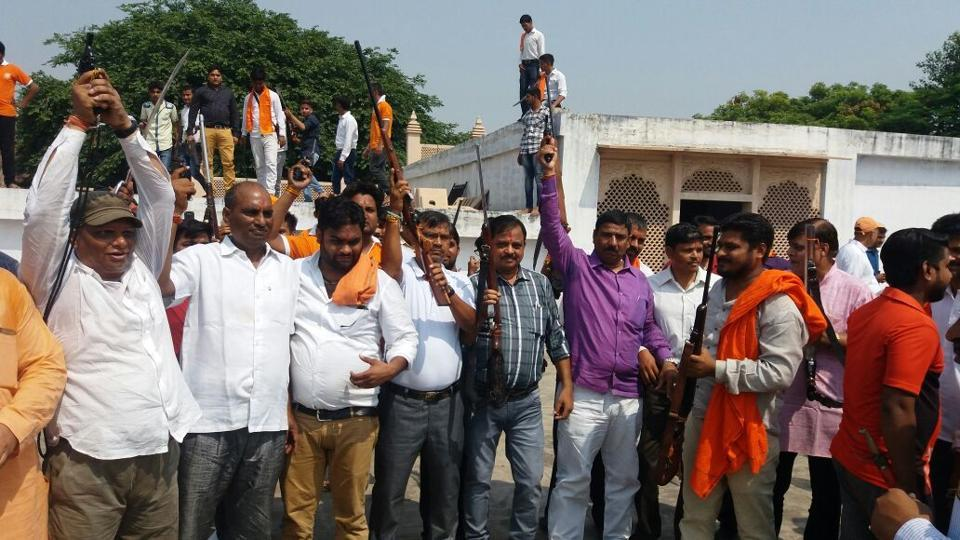 Vishwa Hindu Parishad and Bajrang Dal supporters brandish their weapons after shastra puja on Vijay Dashami in Agra on Saturday.