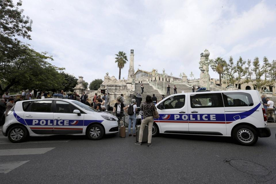 Police cars park outside the Marseille railway station, Sunday, October 1. French police warn people to avoid Marseille's main train station amid reports of knife attack, assailant shot dead.