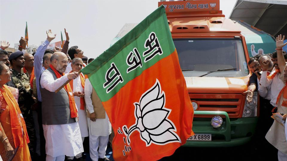 """Bharatiya Janata Party president Amit Shah flags off """"Gujarat Gaurav Yatra"""" ahead of forthcoming assembly elections in Karamsad town of Anand district on Sunday."""