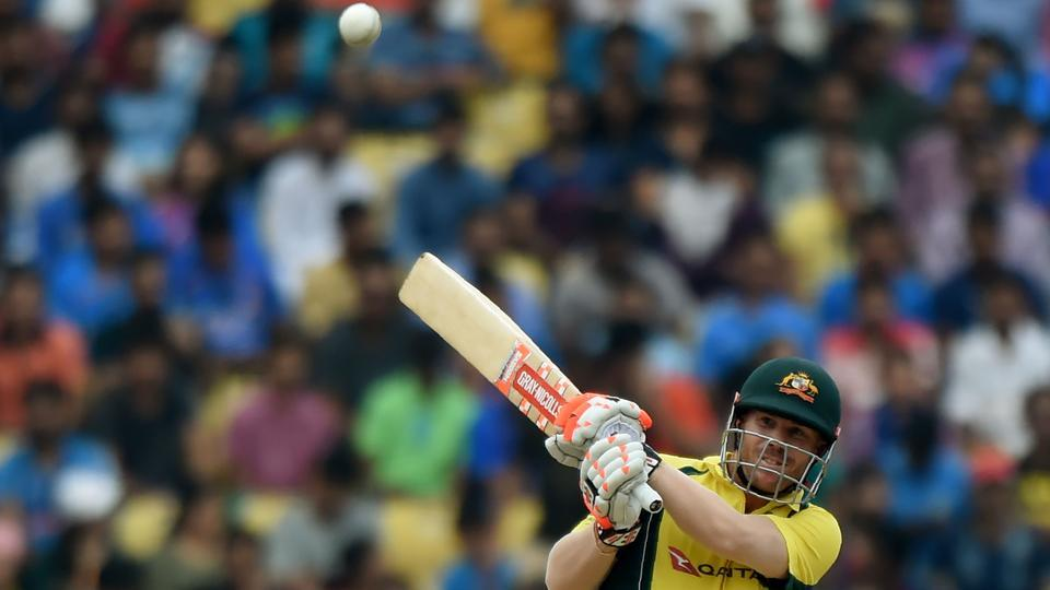 Australian cricketer David Warner plays a shot en route to his half-century during the fifth one-day international match against India at the Vidarbha Cricket Association Stadium in Nagpur.
