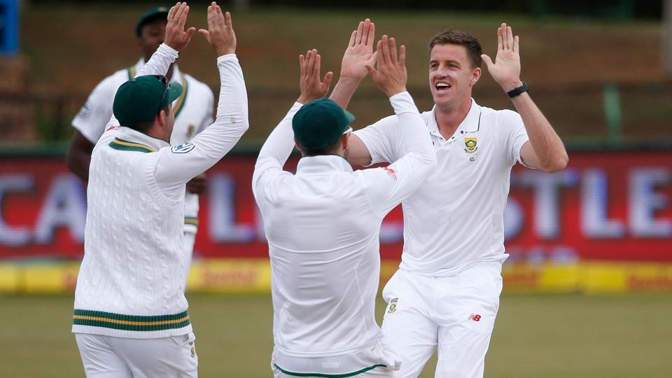 South African bowler Morne Morkel (L) celebrates the dismissal of Bangladeshi batsman Mominul Haque during the fourth day of the first Test on Sunday in Potchefstroom.