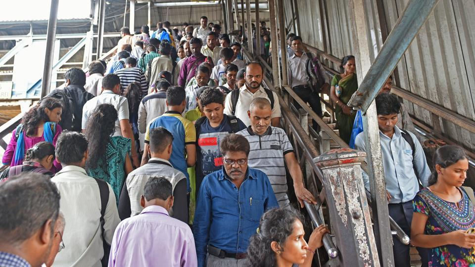People take the foot overbridge where a stampede happened at the Elphinstone Road railway station in Mumbai on Friday.