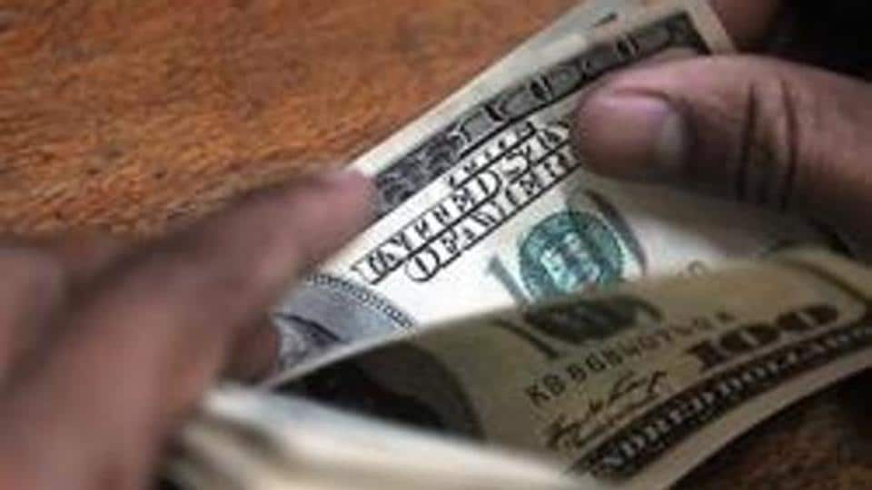 An employee counts US dollars at a Forex dealer's office in Mumbai. India's holding of the securities touched USD 135.7 billion as on July end – the highest in a year, according to the USTreasury department.